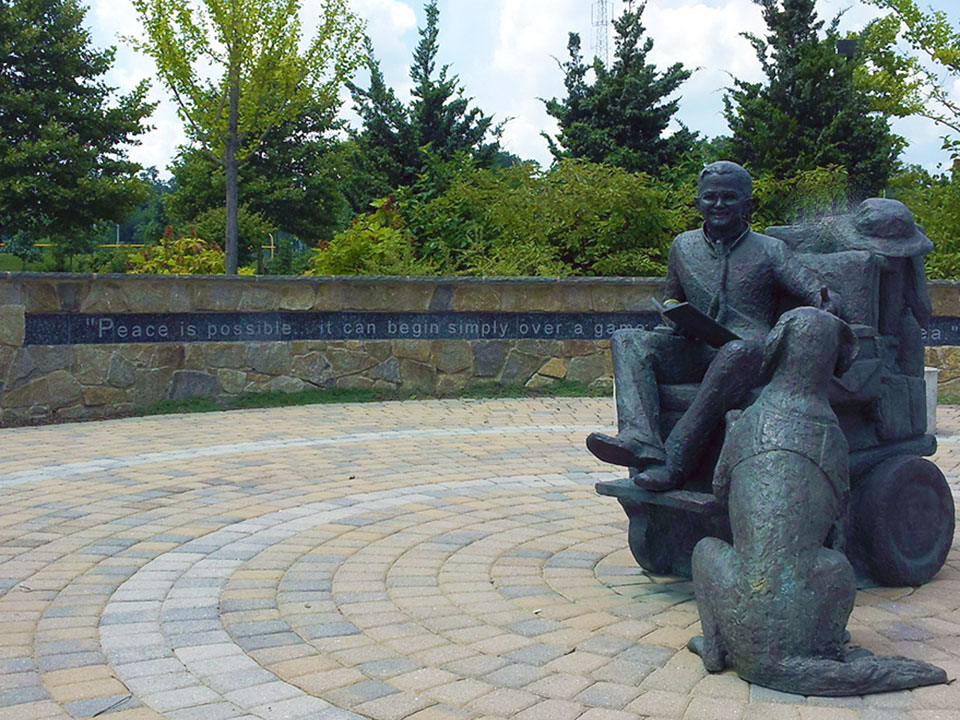 Statue of Mattie with his dog, Micah, at the Mattie Stepanek Memorial Park in Rockville, MD