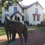 Bronze full-size statue of President Abraham Lincoln outside the Soldiers' Home summer cottage where he and his family stayed, 1861-1864.